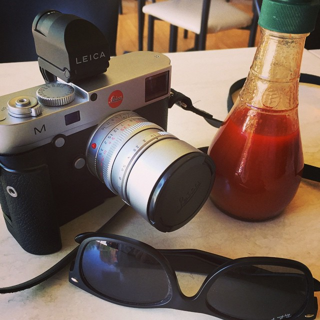 Nothing's  like having lunch with @leica_camera #M240 and some hot #chilly sauce .. #afterRAW #noodles #steamchicken #street #streetphotography #summilux #silver